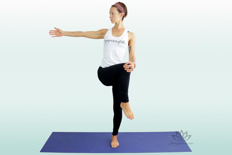 Revolved Extended Hand to Foot Pose variation holding knee - Parivritta Utthita Pada Hastasana